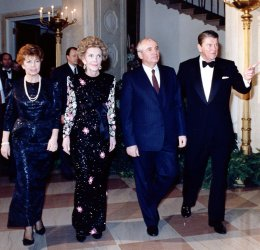 PRESIDENT AND MRS. REAGAN ESCORT MIKHAIL GORBACHEV AND HIS WIFE TO DINNER