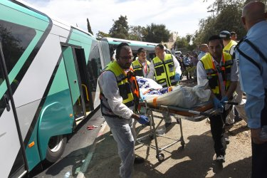 Israeli Emergency Members Remove Terror Victim's Body In Jerusalem