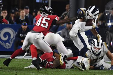 Rams Todd Gurley has  face mask grabbed by Falcons Deion Jones in NFC Wild Card Playoff