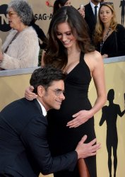 John Stamos and Caitlin McHugh attend the 24th annual SAG Awards in Los Angeles