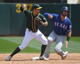 A's Rosales forces Rangers Gallo in Oakland