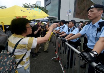 Police guard government building from protesters in Hong Kong
