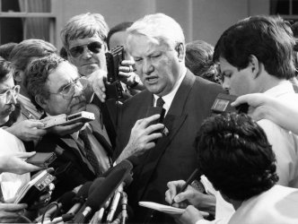 President Boris Yeltsin meets the press after meeting with President George Bush