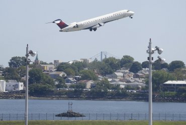 A Delta Airlines plane takes off from LaGuardia Airport