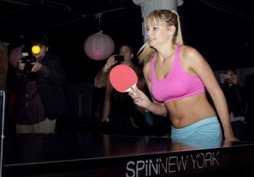 Swimsuit models Genevieve Morton and Jarah Mariano play ping pong