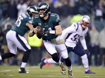 Philadelphia Eagles quarterback Carson Wentz (11) rolls out of the pocket