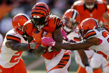Bengals Jeremy Hill break free from Browns Ibraheim Campbell
