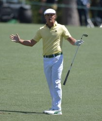 Bryson DeChambeau reacts after a shot on the 8th at the Masters