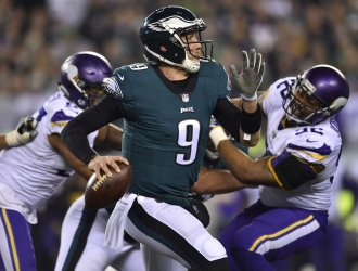 Eagles quarterback Foles rolls out against the Vikings in the NFC Championship
