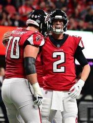 Falcons QB Matt Ryan celebrates his TD on keeper play during an NFL game in Atlanta