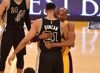 Lakers Kobe Bryant and Spurs Tim Duncan hug before tip-off
