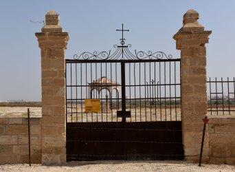 A Danger Mines Sign Hangs At Qasr al Yahud, West Bank