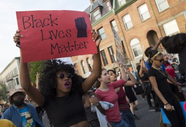 Demonstrators Protest the Death of Freddie Gray in Baltiore