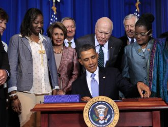 President Obama signs the Violence Against Women Act in Washington