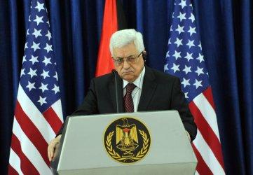 Palestinian President Mahmoud Abbas listens to US Vice President Joe Biden, not seen, make a statement to the press in Ramallah, West Bank