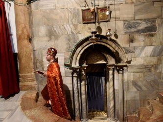 A Priest Walks In The Church of Nativity On Christmas Eve