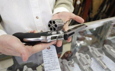 Gun shop owner shows .357 magnum revolver in Dundee, Illinois