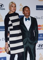 Pharrell and Helen Lasichanh attend the Clive Davis pre-Grammy party in Beverly Hills, California