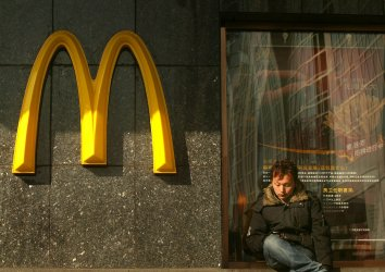 A Chinese man sits outside a McDonald's in Beijing