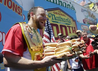 Joey Chestnut celebrates at the Nathan's Famous Hot Dog Contest