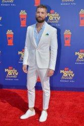 Dustin Milligan attends the MTV Movie & TV Awards in Santa Monica, California