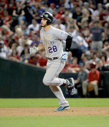 Rockies' Arenado rounds the bases after home run