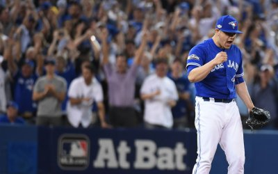 Blue Jays closer Osuna reacts after win in the ALCS game four