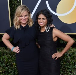 Amy Poehler and Saru Jayaraman attend the 75th annual Golden Globe Awards in Beverly Hills