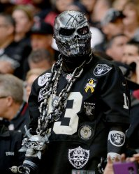Raiders' fan looks ove the crowd