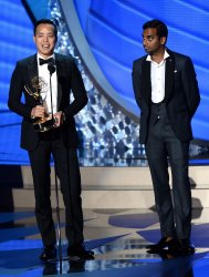 Alan Yang and Aziz Ansari win an award at the 68th Primetime Emmy Awards in Los Angeles