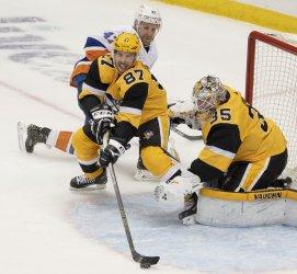 Pittsburgh Penguins Sidney Crosby Clears Pucks