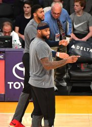 Pelicans DeMarcus Cousins and Anthony Davis warm up in Los Angeles