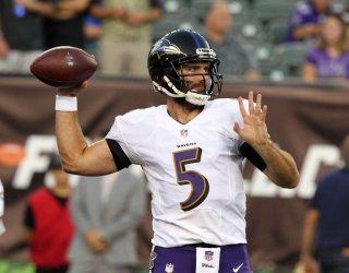 Baltimore Ravens quarterback Joe Flacco hrows during warm ups