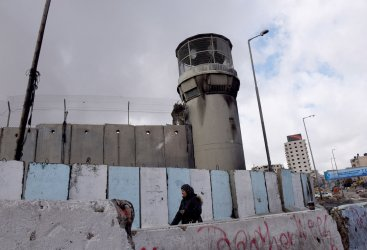 Palestinians Cross The Qalandiya Checkpoint Between Jerusalem and Ramallah