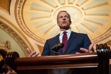 U.S. Sen. John Thune speaks to press