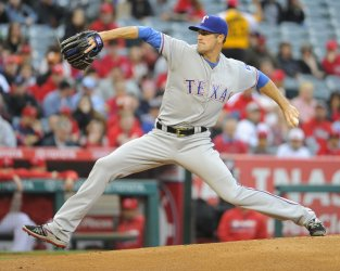 Texas Rangers starting pitcher Cole Hamels pitches against the Los Angeles Angels