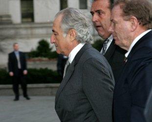 Financier Bernard Madoff pleads guilty in New York