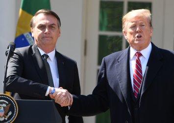 President Donald Trump greets Brazilian President Jair Bolsonaro at White House