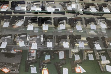 Semiautomatic handguns displayed at gun shop in Dundee, Illinois
