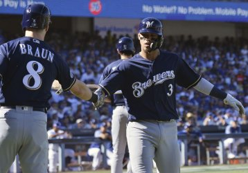 Brewers Arcia celebrates scoring with teammate Braun in NLCS Game Five