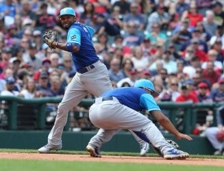 Royals Escobar attempts to throw out Indians Guyer