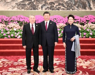 Xi, Peng and Nazarbayev pose for a photo at the BRF in Beijing, China