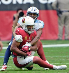 Cardinals' Fitzgerald is tackled