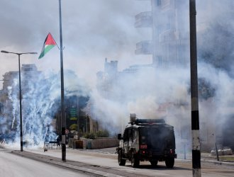 Israeli Soldiers Fire Tear Gas At Palestinian In Bethlehem