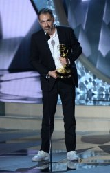 Miguel Sapochnik wins an award at the 68th Primetime Emmy Awards in Los Angeles