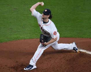 Astros pitcher Cole throws in World Series in Houston