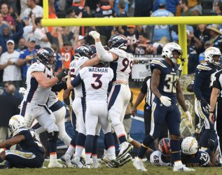 A dejected Chargers Derwin James (R) walks off in loss against the Broncos on a last second field goal