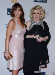 TV Personalities Joan Rivers (R) and Melissa Rivers attend the Clive Davis pre-Grammy party in Beverly Hills, California