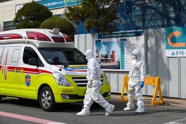 Hospital Workers in Biohazard Suits Walk in Daegu