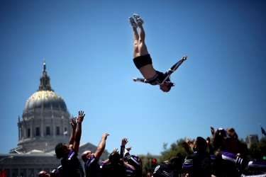 A cheerleader performs a flip at San Francisco's 40th annual LGBT Pride Parade